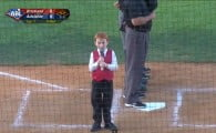 Little boy battles through the hiccups while singing the anthem